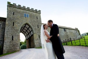 Bride and Groom Outside the Portcullis at Clearwell Castle